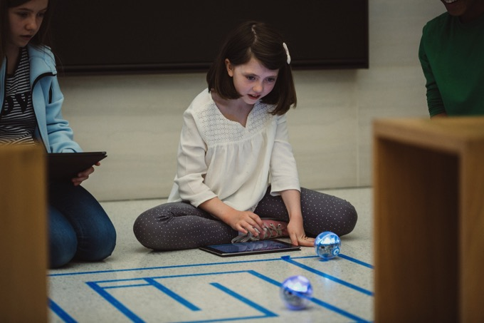 Swift playgrounds children playing robots